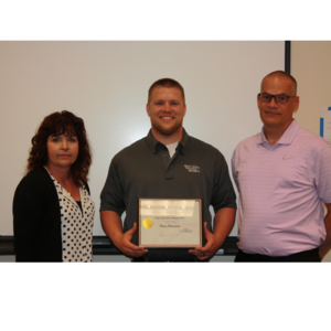 Shea Hansen receiving his award.