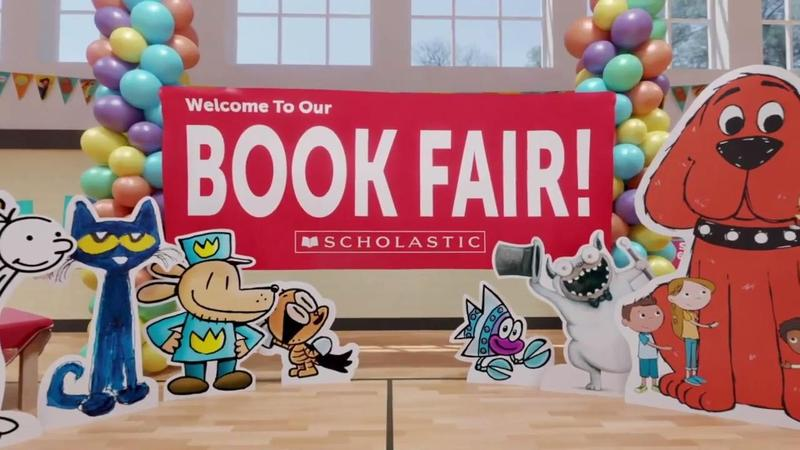 scholastic book fair banner with various book character cutouts