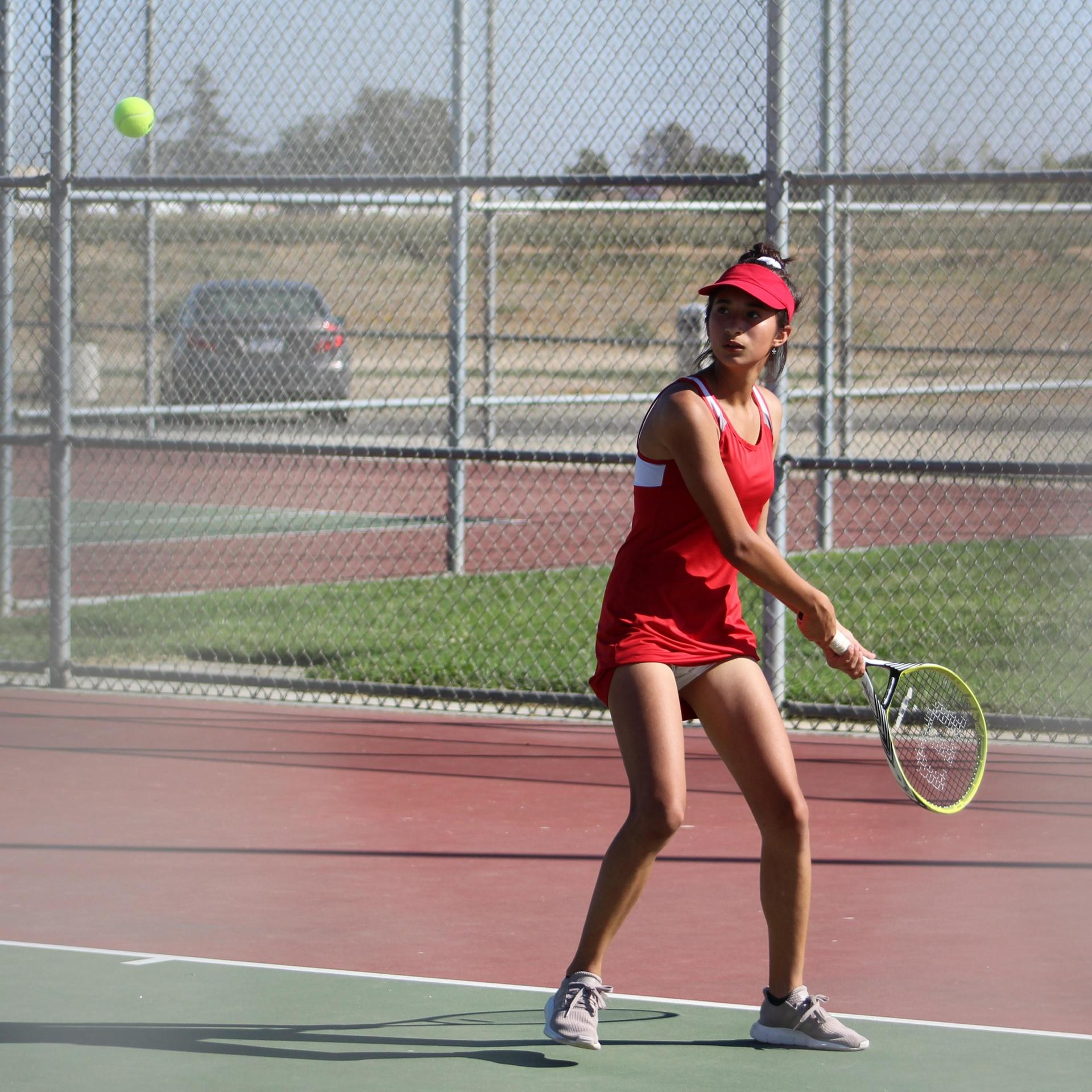 girls playing tennis against Dos Palos