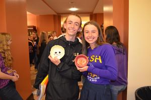 A photo of two students showing the bowls from the event