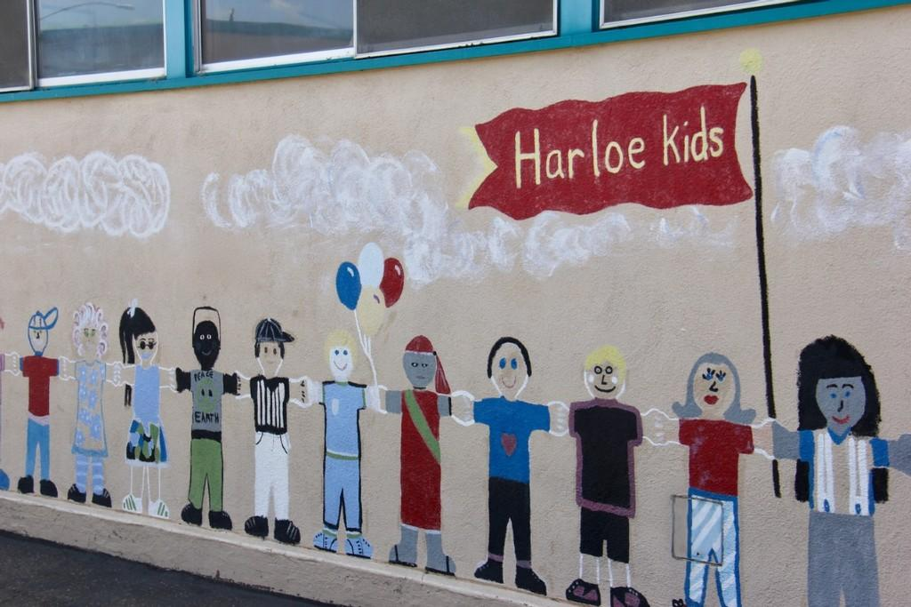 a picture of a mural at the school featuring lots of different kinds of kids