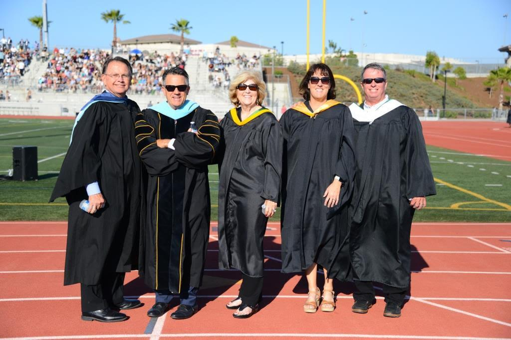 Principal Flynn and other distinguished guests at graduation