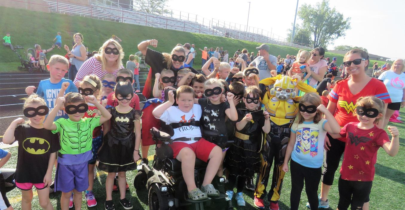 A super class of first graders take part in the superhero-themed walk-a-thon.
