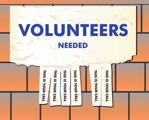 Sign that says volunteers are needed.