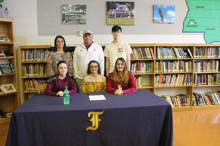 Jami Dawn Walker signing a scholarship with Colin Soccer team.