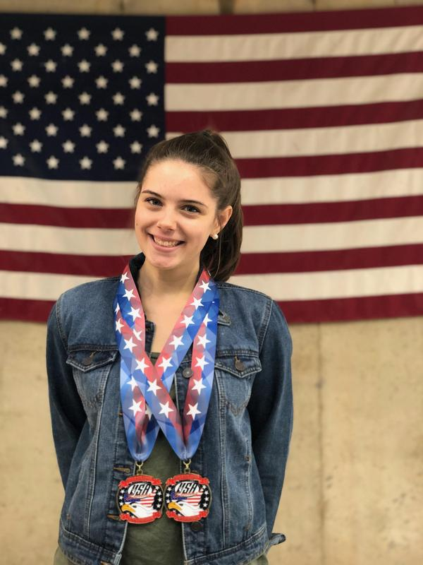 Katie Ezell with Jr. Olympics medals