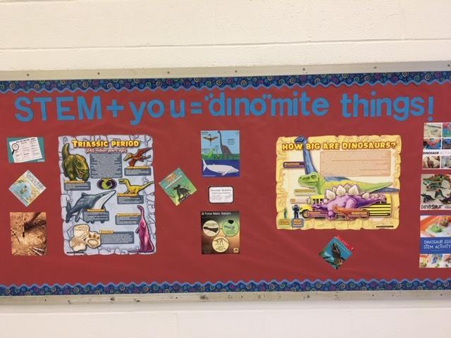 bulletin board that says 'STEM plus you = dinomite things'