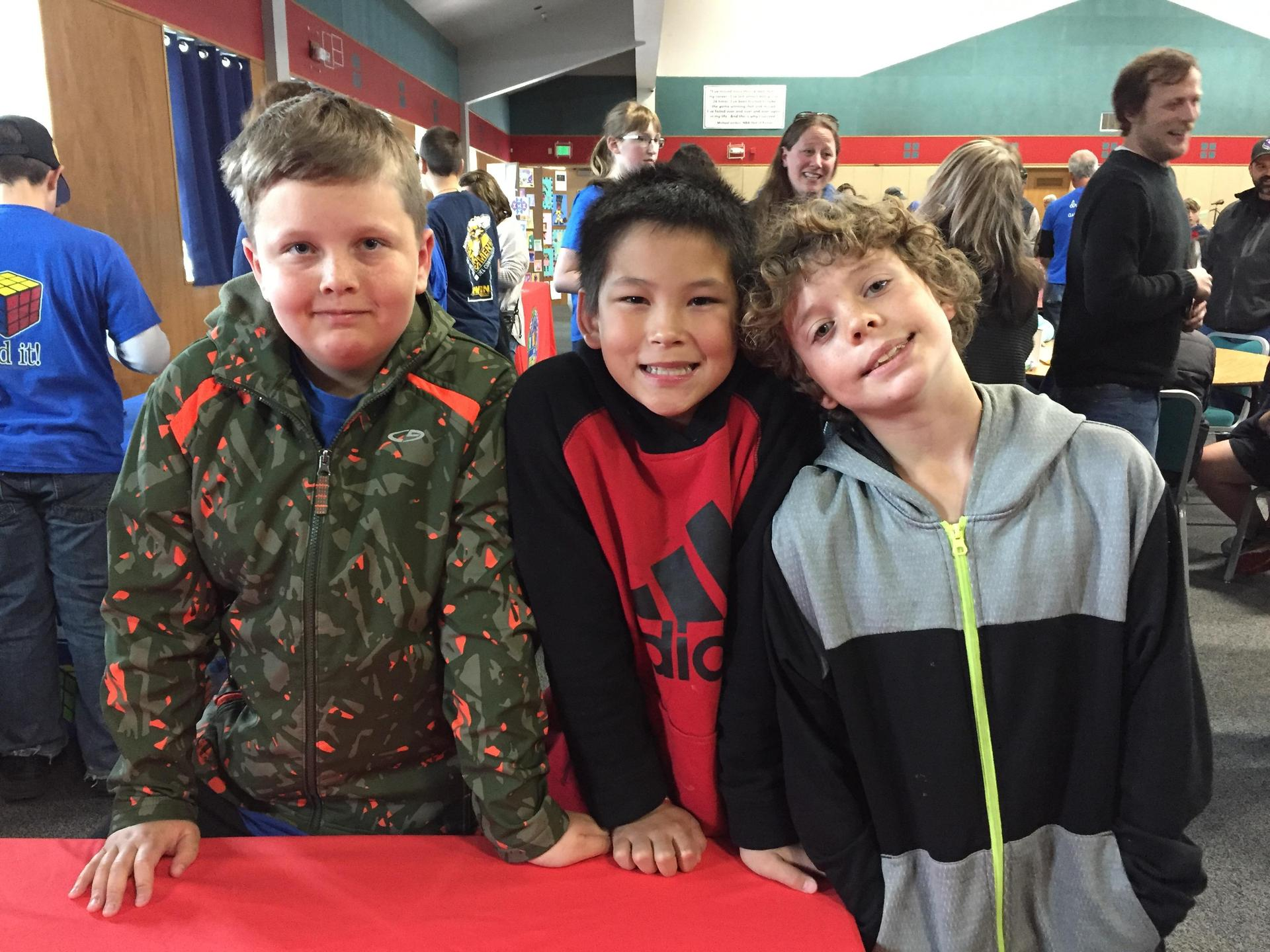 three boys at math competition