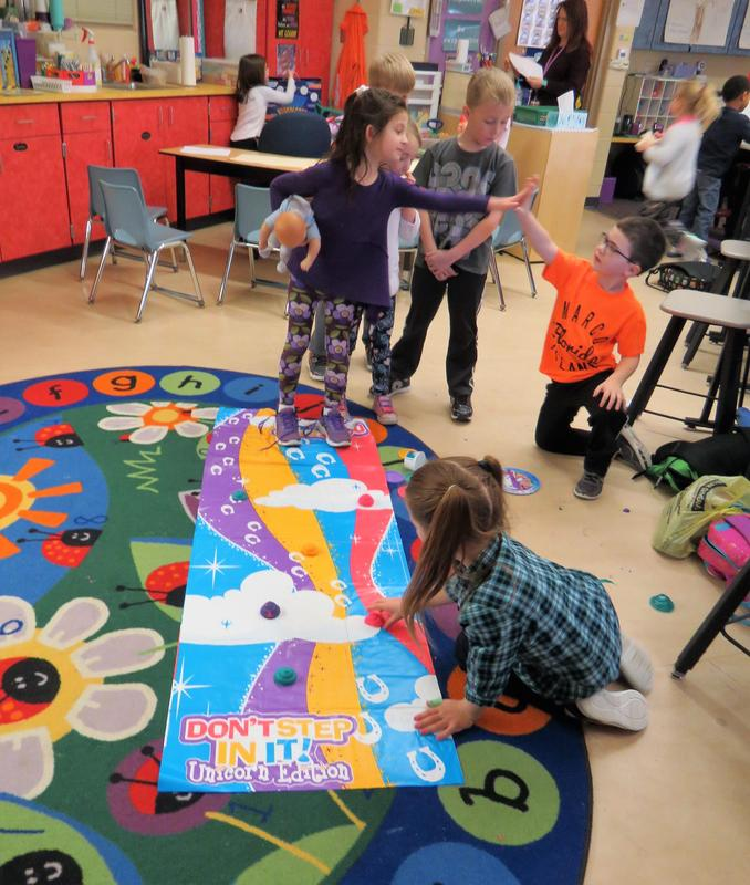 Students play a game of Don't Step In It - Unicorn Version during Global School Play Day.