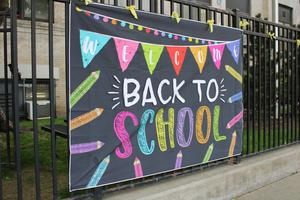 Welcome back to school sign outside school