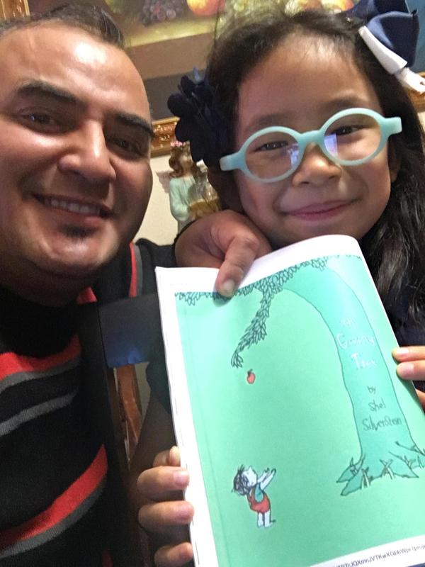 Student with dad and book