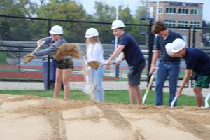Students take part in shoveling dirt at the event