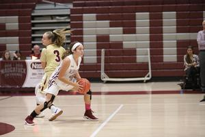 Two girls playing basketball