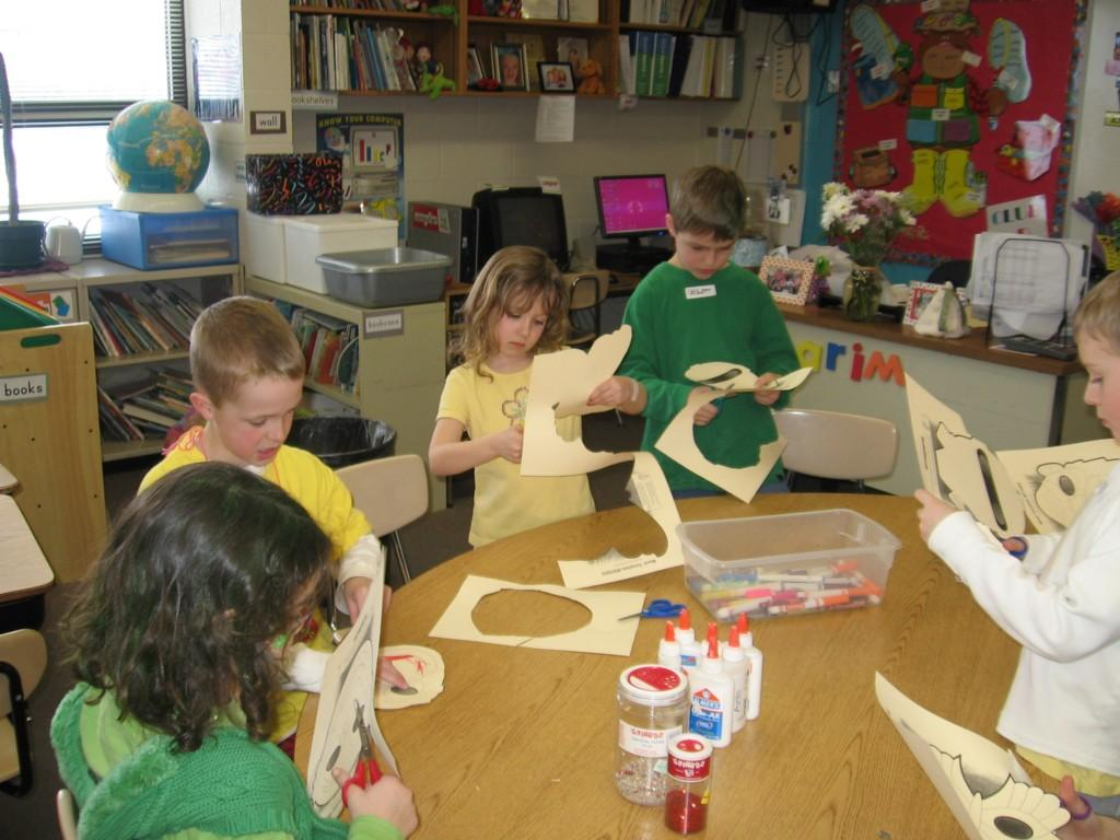 students create artwork at tables