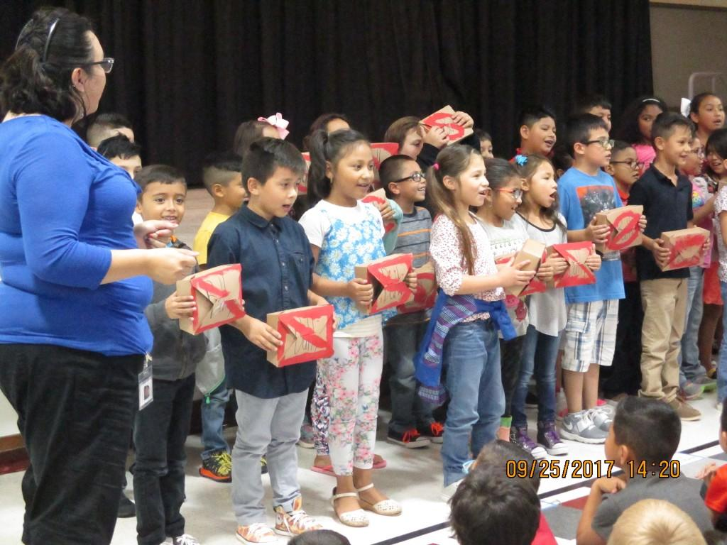 1st Graders sing for the kickoff
