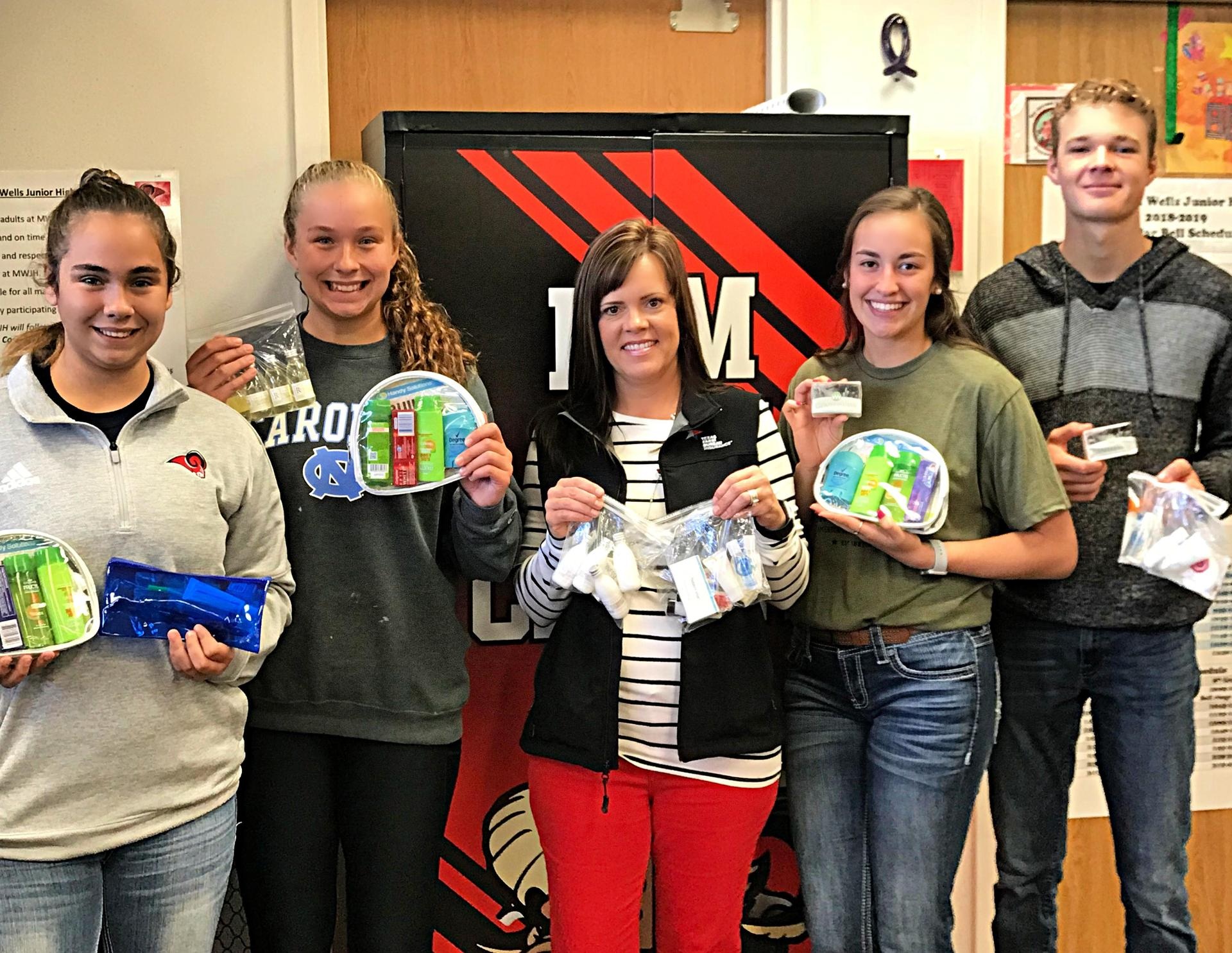 Interact Members accept Zonta donation for care closet