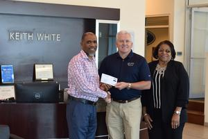 keith White Ford presents Gold-Level Sponsorship check to McComb School District Superintendent.