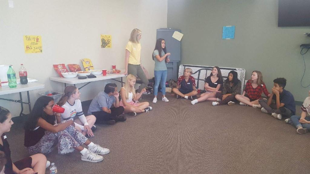 """Picture of ASB President leading a """"getting to know you"""" game"""