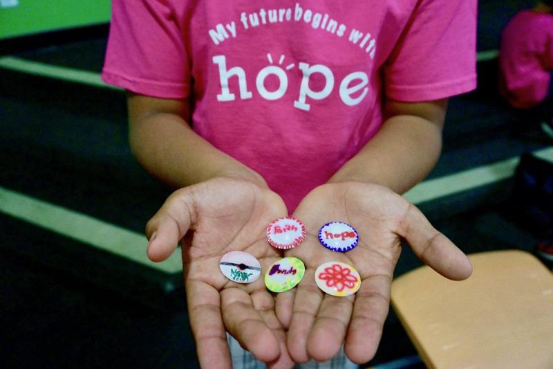 Student's Hands Holding Resilience buttons
