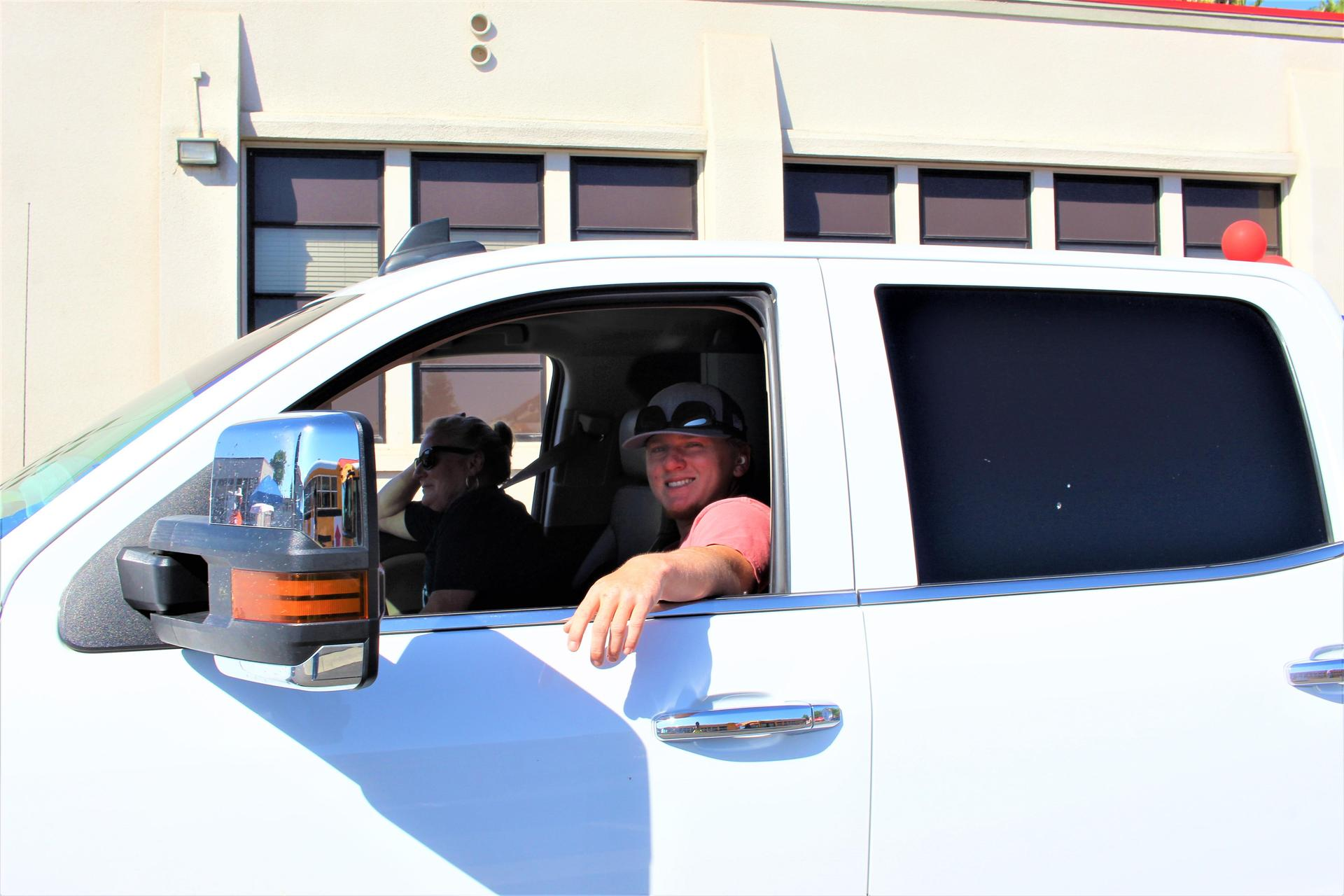 Shane Lewis driving through