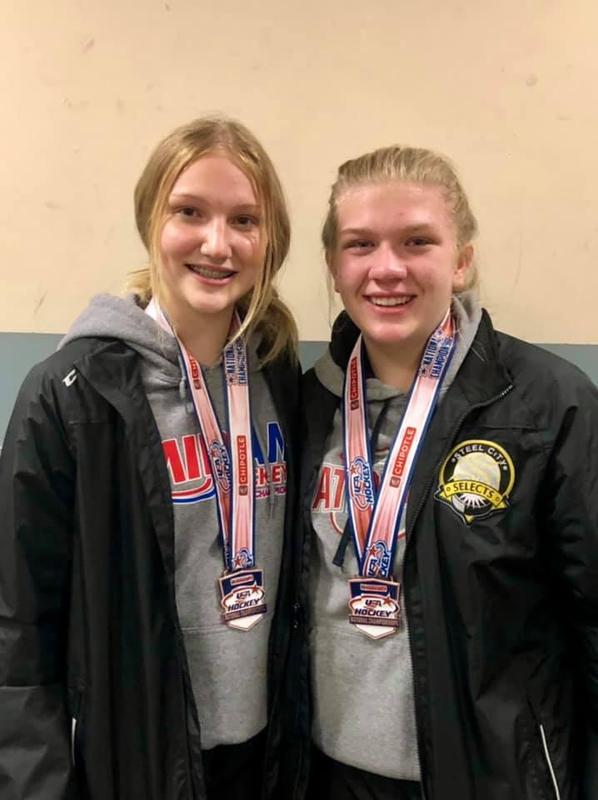 two hockey girls with medals