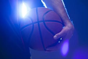 front-view-basketball-held-by-player_23-2148432568.jpg