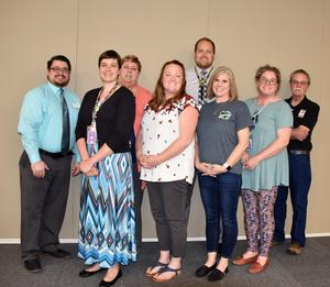 Back row: HSD Board Vice-Chair and HEF Member Josh Goller, HSD Board Chair and HEF Member Karen Sherman, HEF Member and Rocky Heights Principal Jerad Farley, and HEF Chair Dr. George Clough.  Front row: Rebecca Crawford, Shareana Sparks, Tammy Mayer, and Delia Fields, not pictured High School Agriculture Instructor Brianna Smith