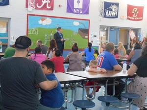 Mr. Gruber speaks with kindergarten students and parents
