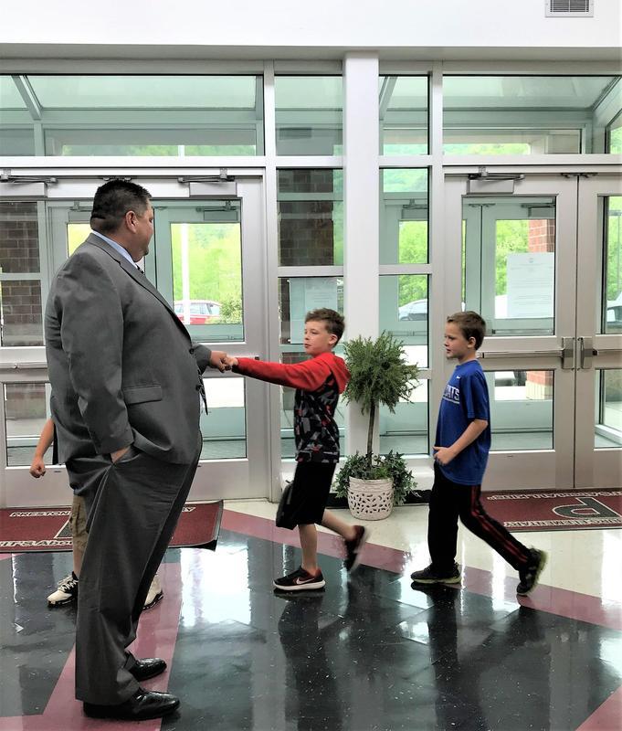 Adkins fist bumping student