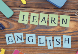Words , wooden background that says Learn English