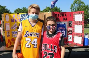 Photo of two Wilson 5th graders as two sports figures during Wax Museum
