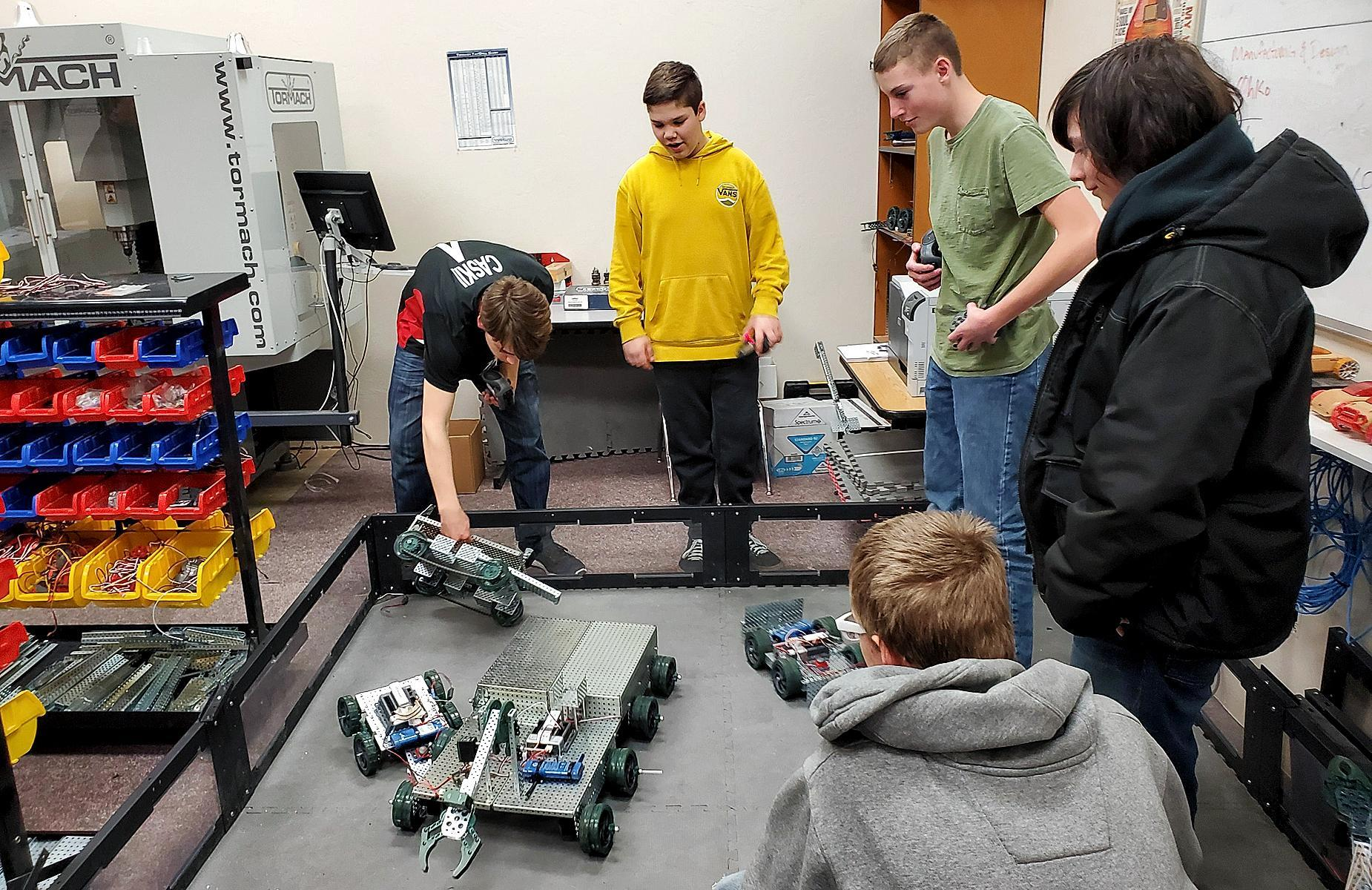 Student battling robots