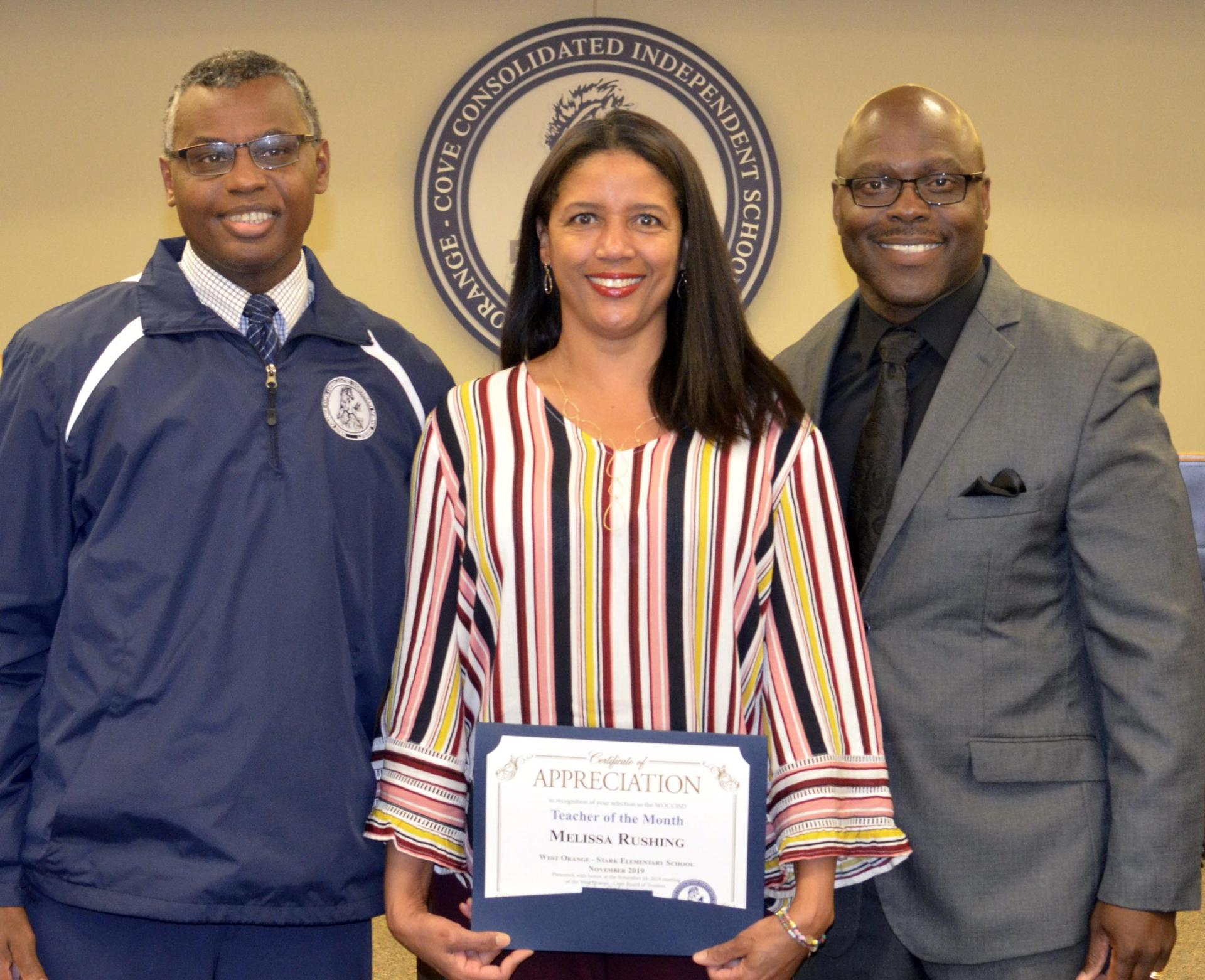 Melissa Rushing, Teacher of the month for November is pictured with Principal Dr. Bethley and Superintendent Dr. Harris
