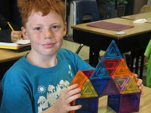 This student used the MagnaTiles to build a structure.
