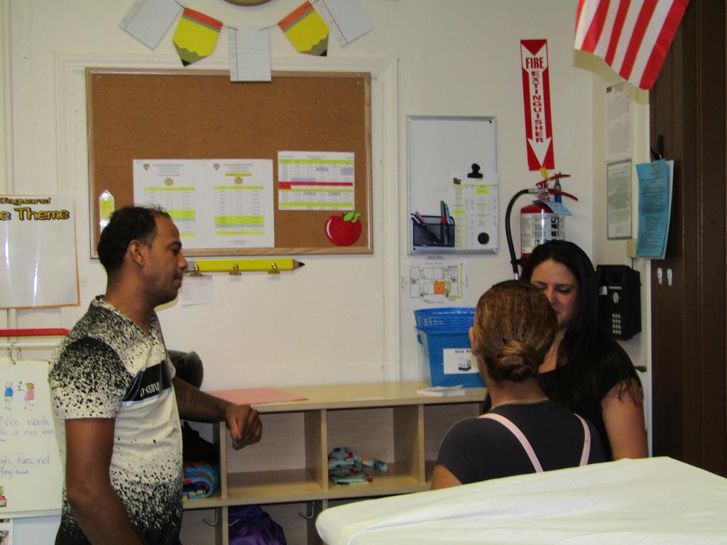 parents talking to classroom teacher at the door