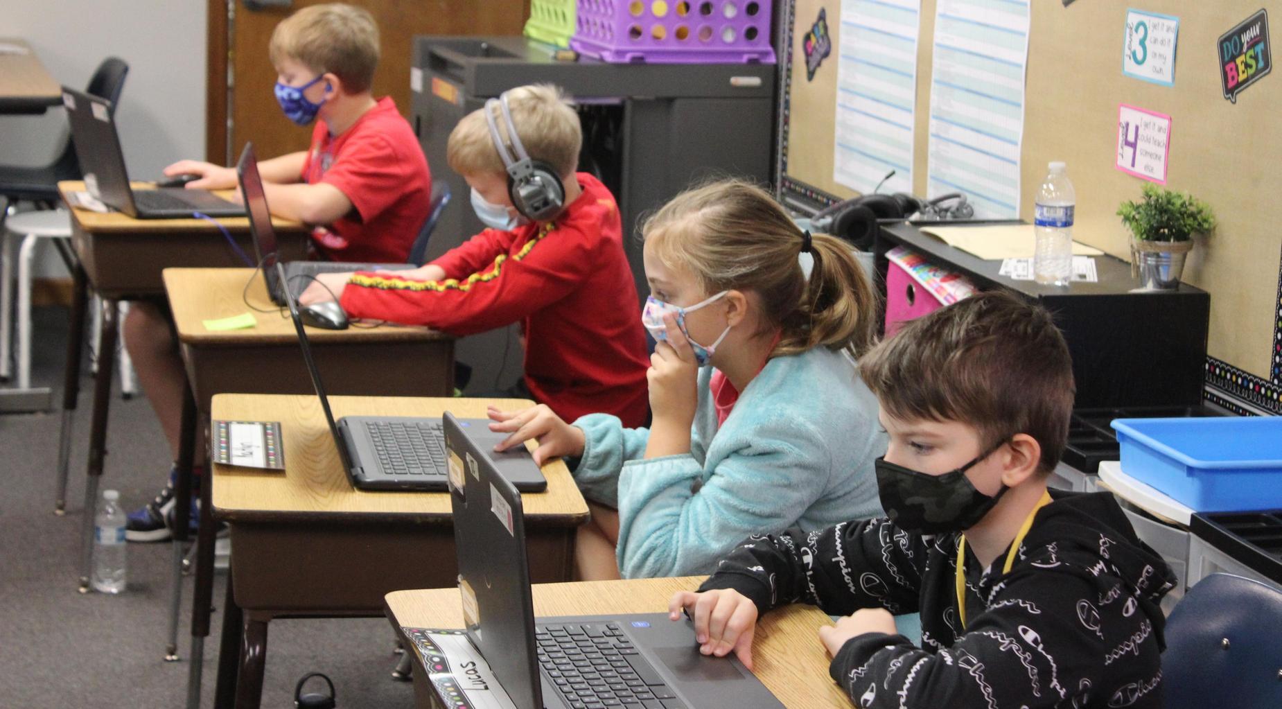 Students work on digital classwork.