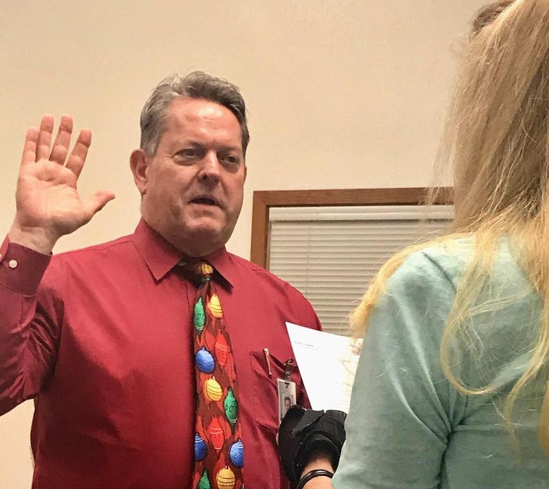 Superintendent being sworn in