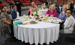 Group seated at table smiling