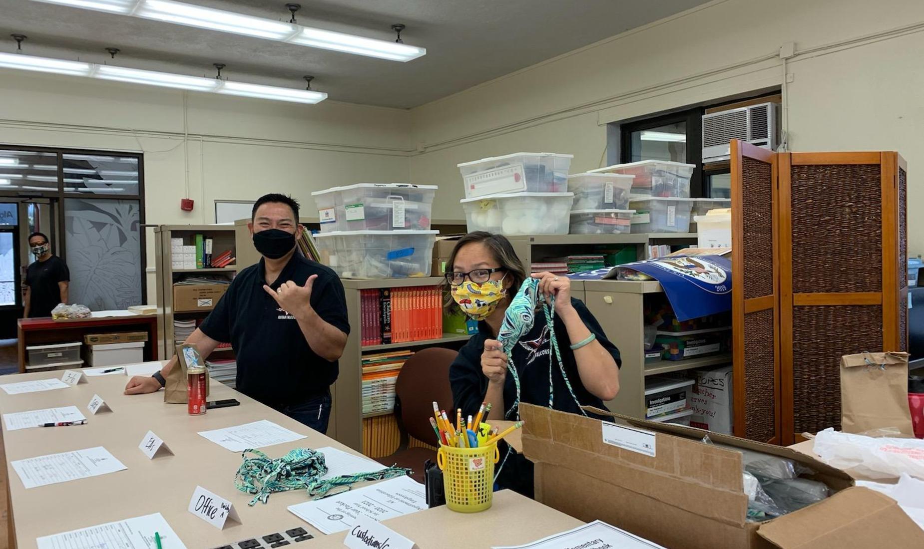 Staff opening box of masks