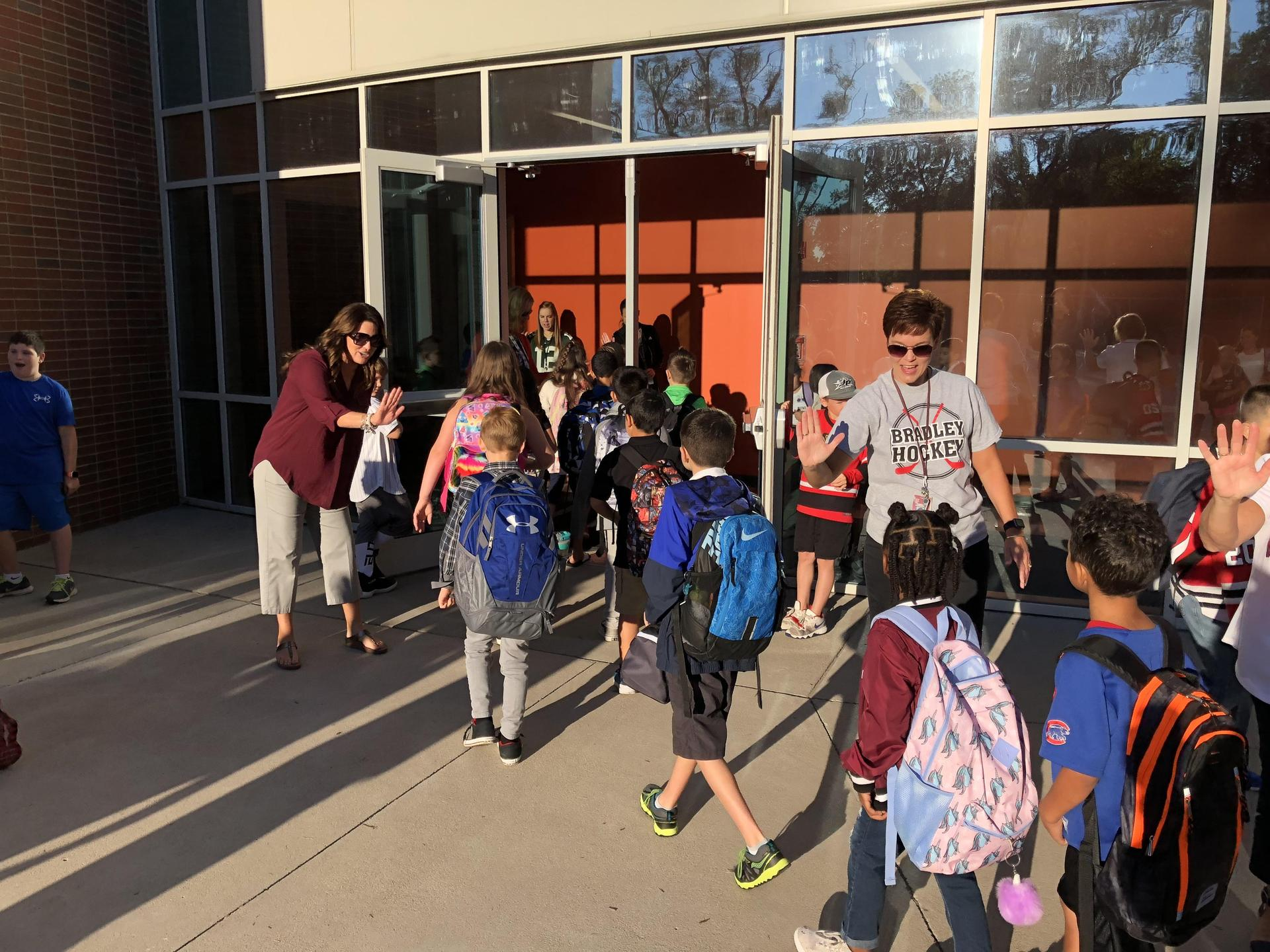 Hamilton Elementary  students receiving a high five as they enter school.
