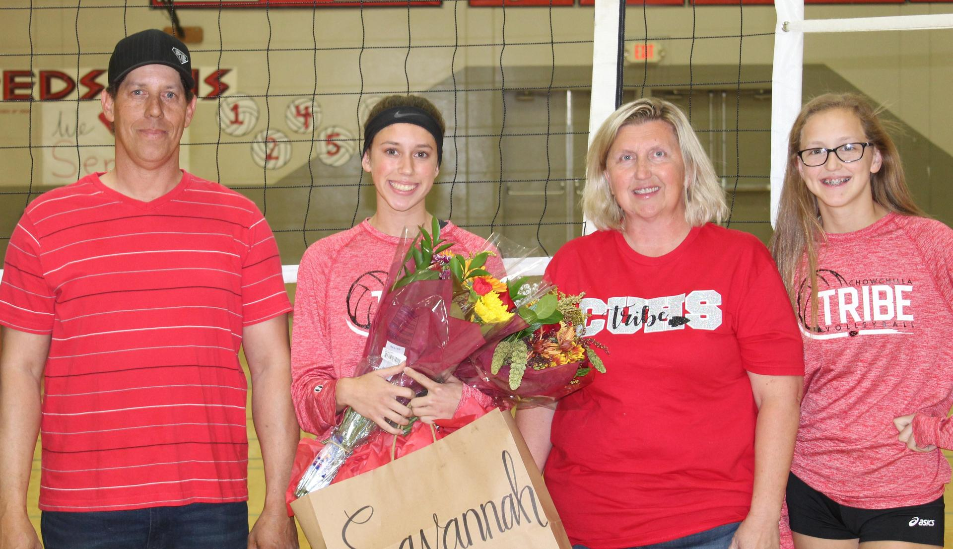 Savannah Bass and Lauren Bass with their parents on Volleyball Senior Night.
