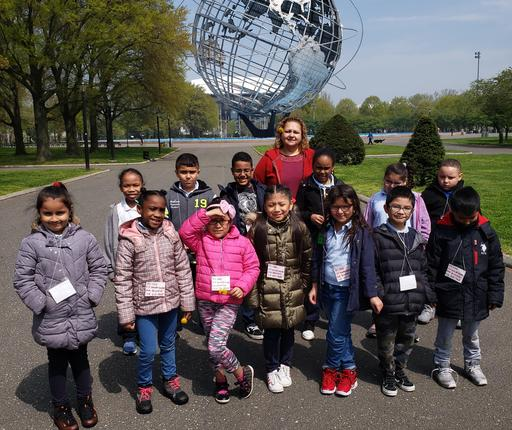 Group of 3rd Grade Students on group pic with a giant monument of the globe in background.