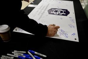 Banner Signing.JPG