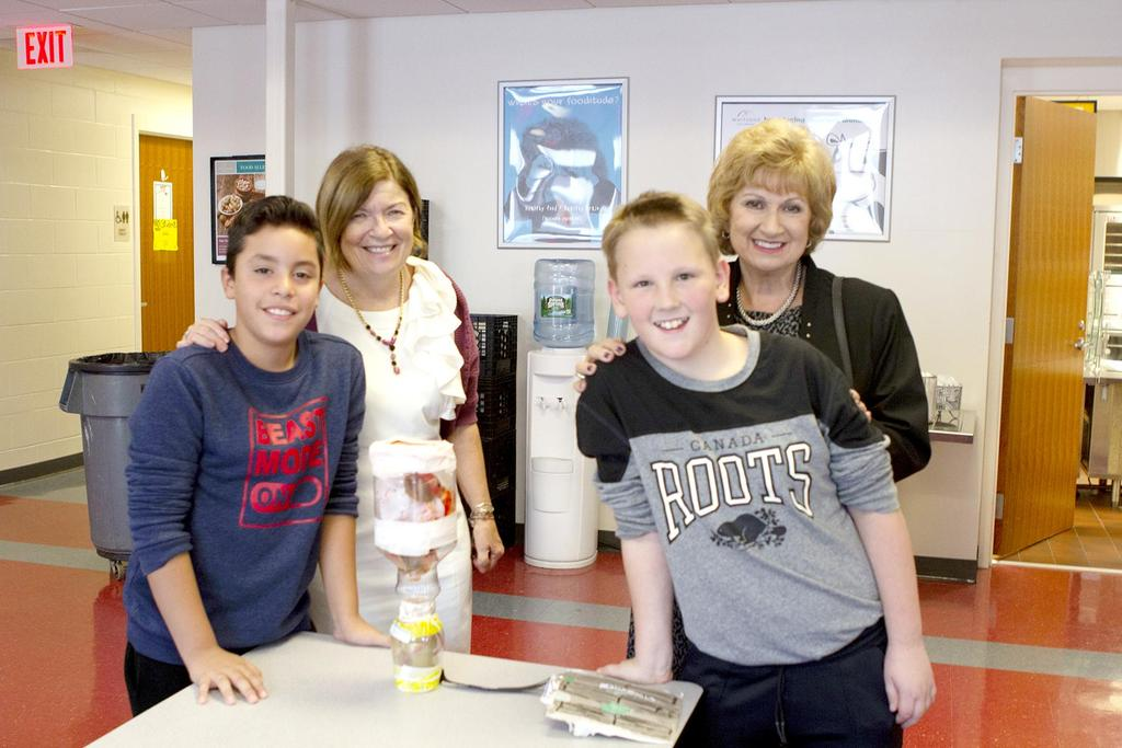 Two students are pictured with Principal Denise Hanlon and Superintendent Janice Gauthier
