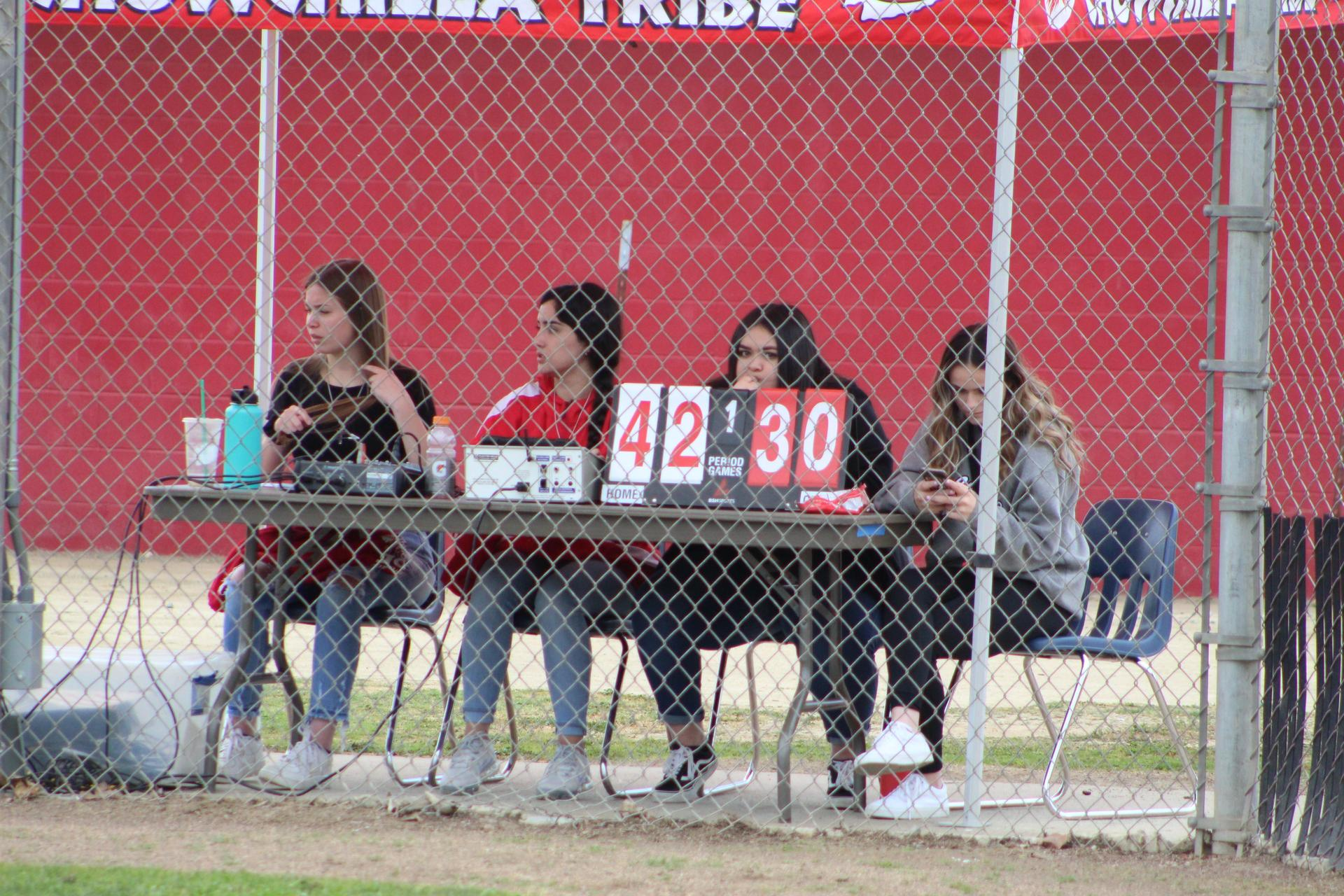 scorekeepers and the announcer