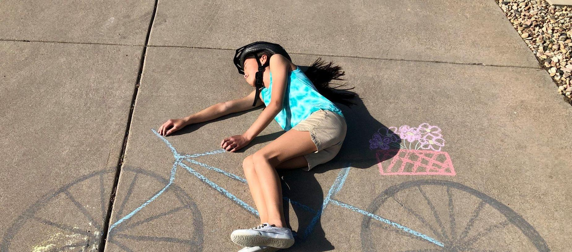 Student with Chalk Art Bicycle