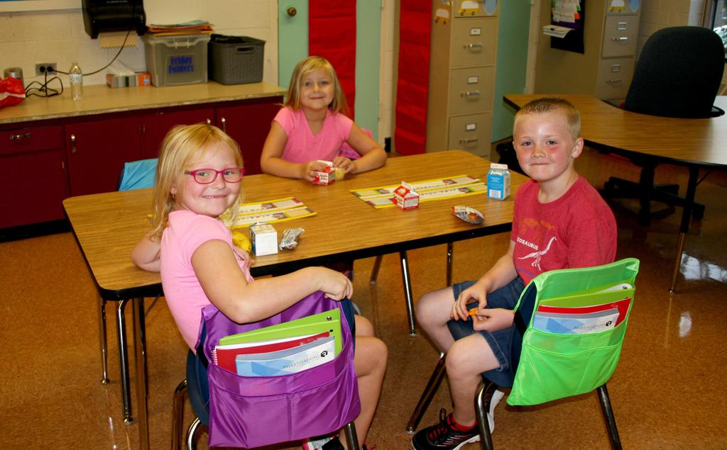 Kids smiling from their desks on the first day of school at Mt. Pleasant Elementary.
