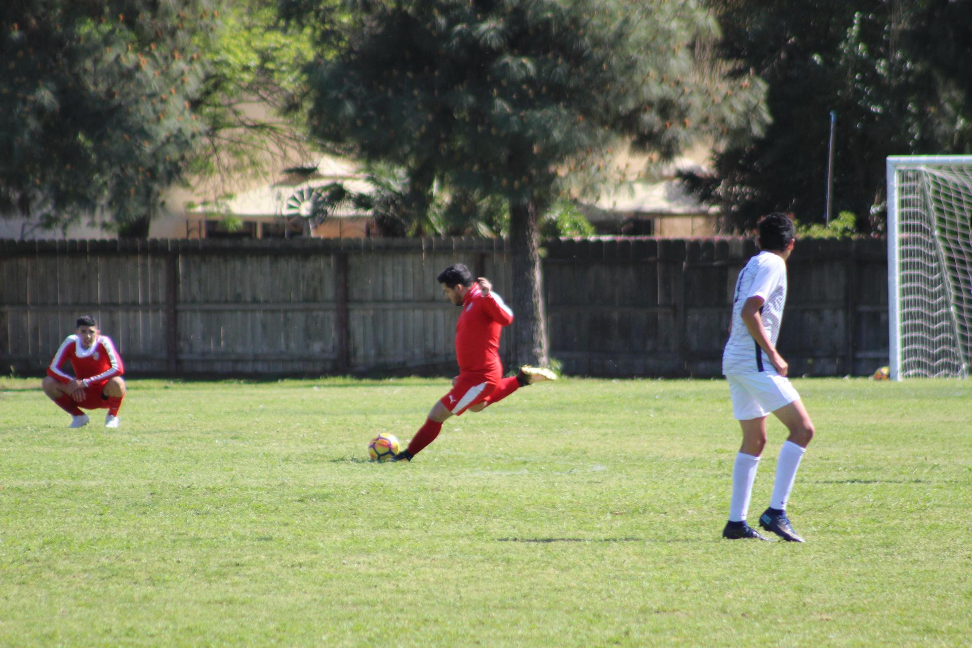 varsity boys playing soccer against san joaquin memorial