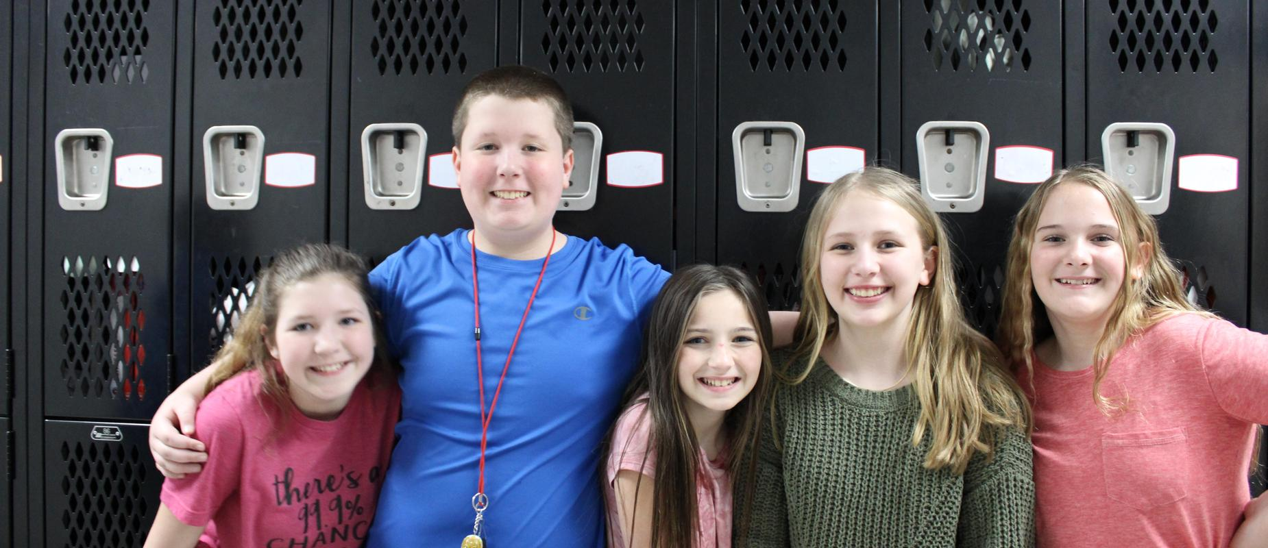 friends in front of lockers