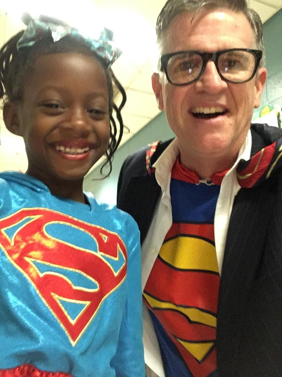 Mr. B. and a student dressed as super heroes